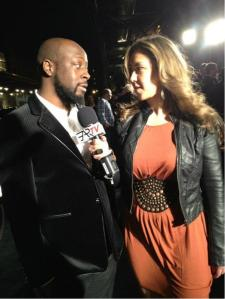 """With Wyclef Jean at the New York Auto Show."""