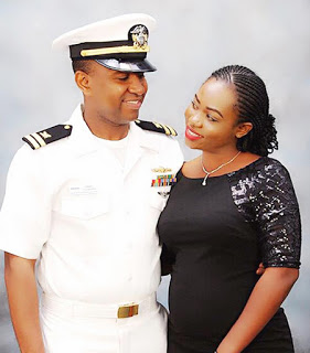Lt. Ismael Tounkara poses with wife during award ceremony